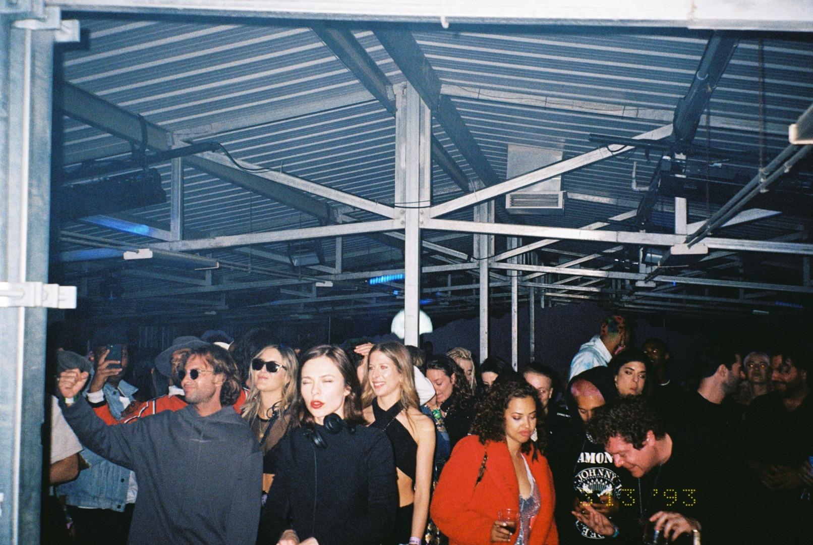 "alt=""Coachella crowd listens to music inside"""