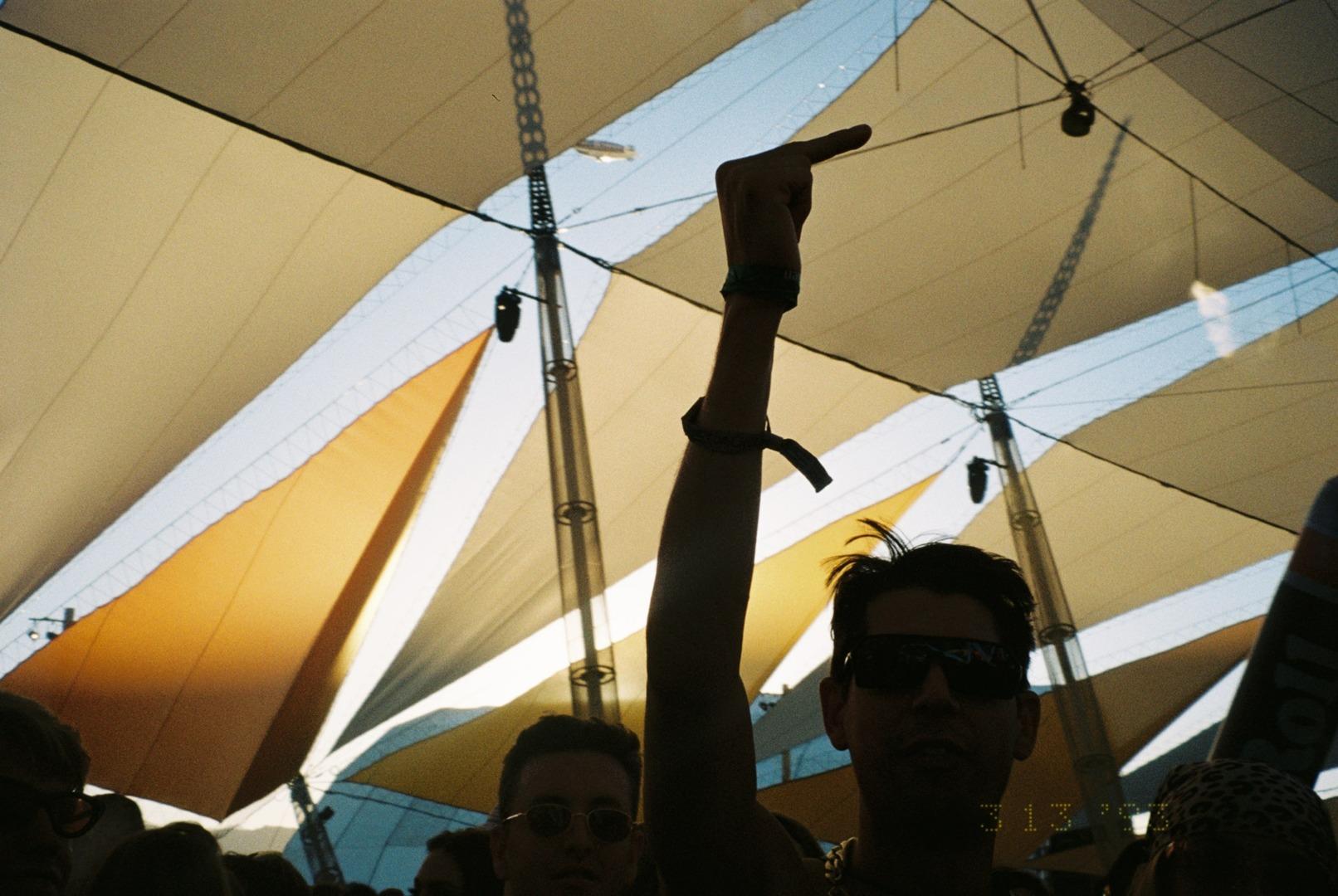 """alt=""""Man under canopy holds up middle finger"""""""