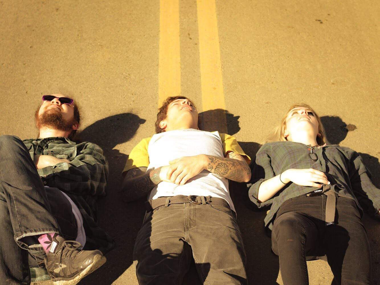 alt=backseat vinyl band laying in street