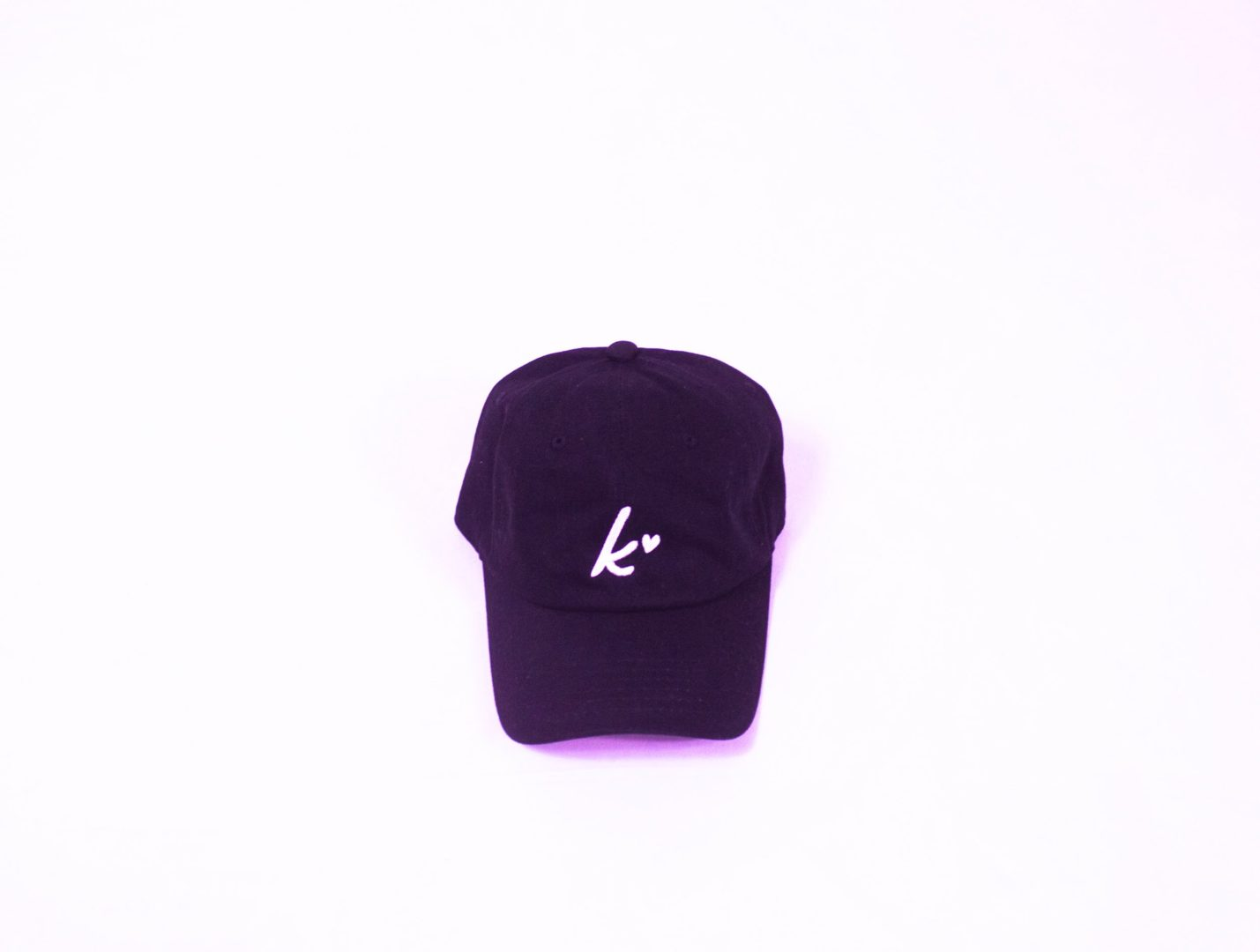 "alt=""Black Kollection ball cap hat with K and heart"""