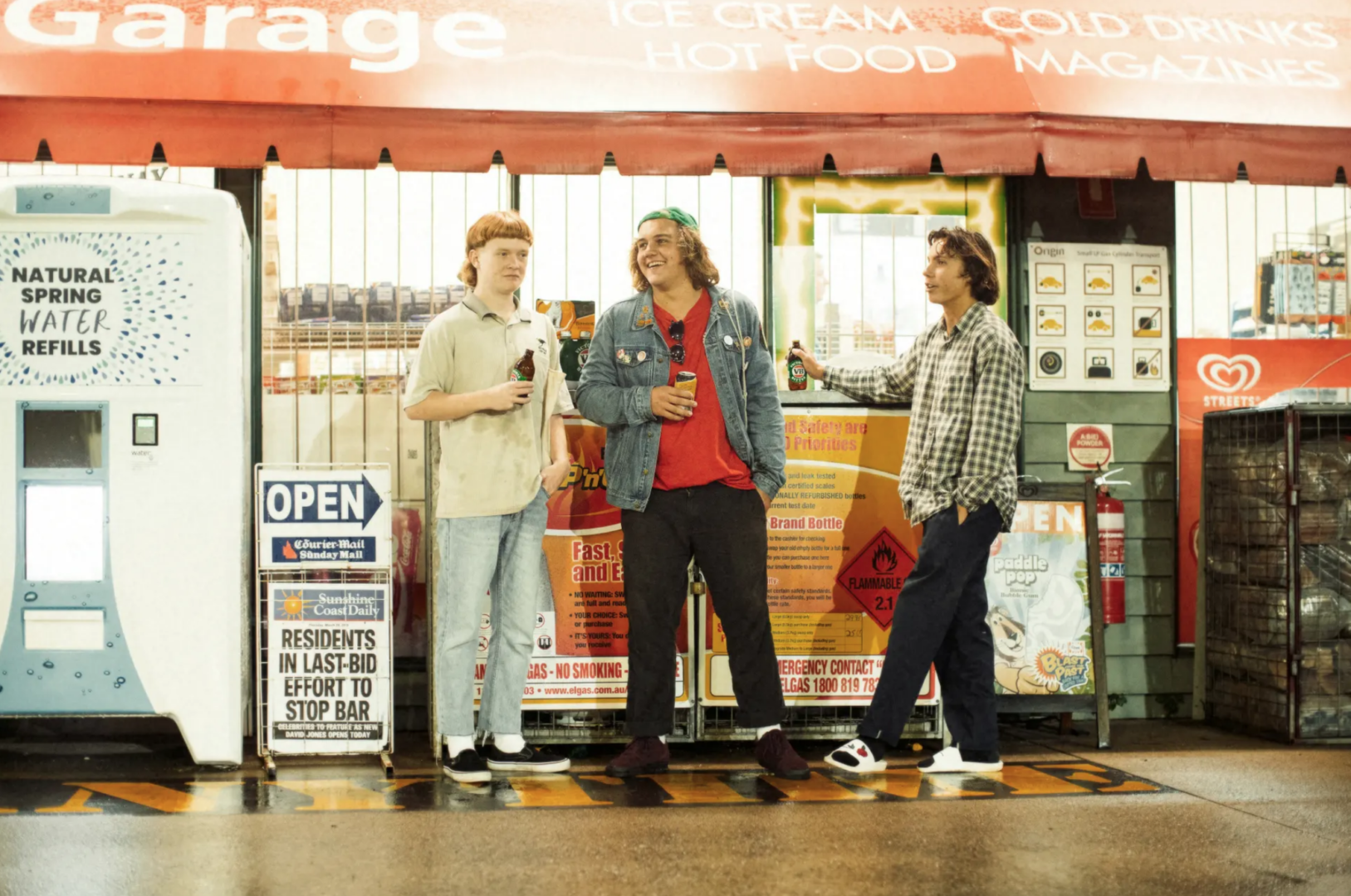 "alt=""The Chats band in front of liquor store"""