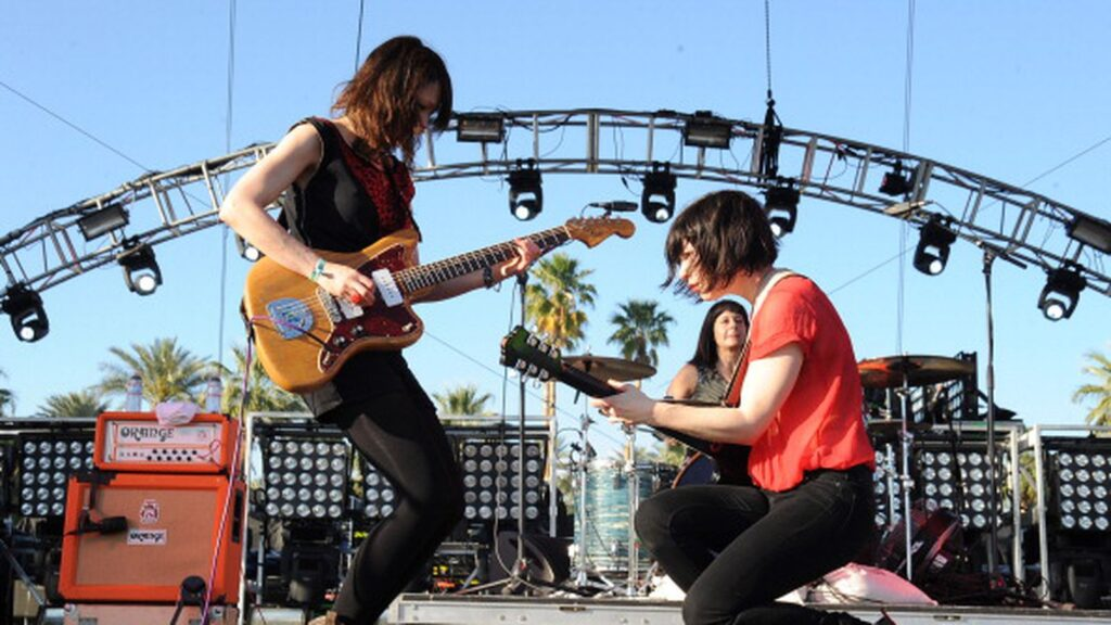 white flag performing on stage at coachella