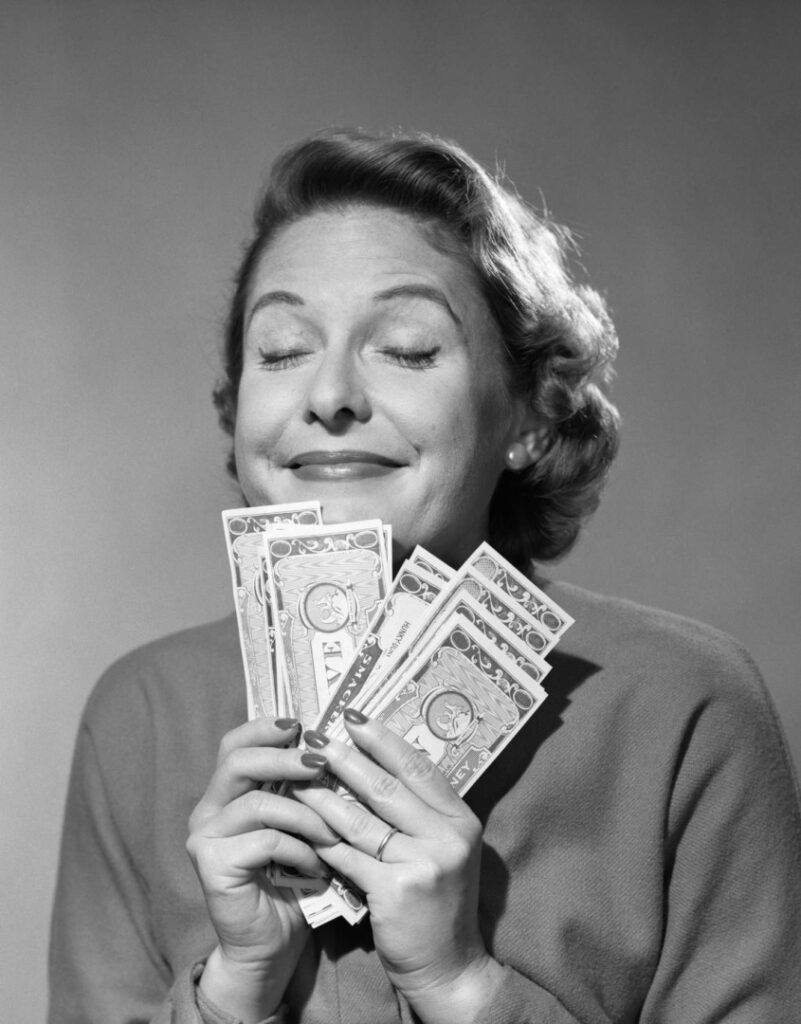"Alt=""50's women holding dollar bills"""
